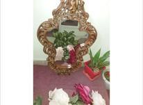 آینه چوبی منبت دست در شیپور-عکس کوچک