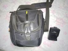 کیف دوربین عکاسی به همراه یک عدد رم 32 گیگ و کیت نظافت لنز در شیپور