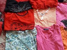 تعدادی زیادی لباس زنانه در شیپور