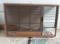 کلید.جلو پنجره و موتور فن با پره فن در شیپور-عکس کوچک