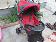 کالسکه قرمز کودک در شیپور